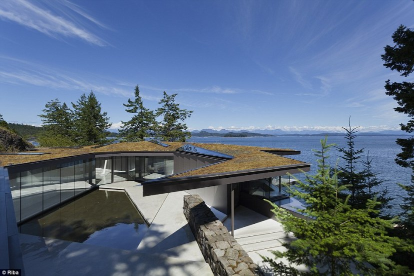 Tula House was designed as a home for a married couple inHeriot Bay, six hours' drive north of Vancouver in Canada. It also doubles as the home for their charitable foundation. The remote clifftop location is surrounded by stunning scenery