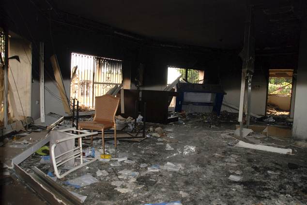 Terrorists looted the diplomatic compound after murdering the ambassador and assistant Sean Smith