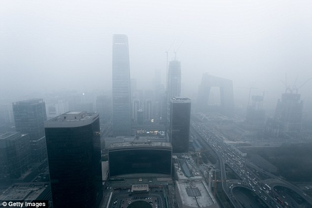 Experts worry that when 400ppm becomes the norm, polluted and densely populated cities such as Beijing (stock image) could record carbon figures as high as 700ppm, bring a lot of health concerns