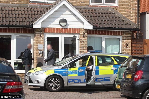 Police outside a hospital in Croydon yesterday where a male nurse was stabbed to death