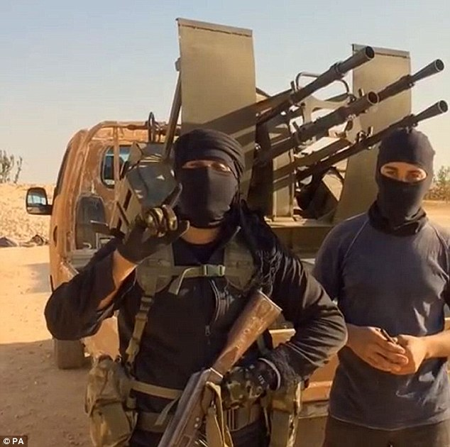 Despite links to a jihadi faction (pictured) that encouraged other so-called 'Lions' in the UK to take up arms in the Middle East, the father of two has been able to return from the battlefield to a comfortable life in Britain