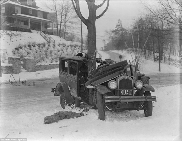 This photo powerfully coveys the danger of driving on roads in the 1930s during winter, the icy roads appear to have been too much for this car to handle and it is literally wrapped around a tree after a crash in the village of Auburndale in Massachusetts