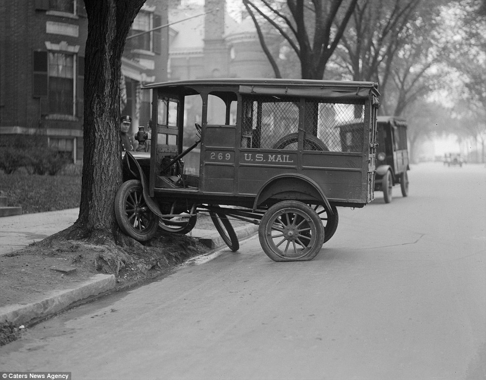The mail could have been a little late after this crash and the photo also offers a compelling insight into the design of the early automobiles - which by the looks of the truck - were very limited