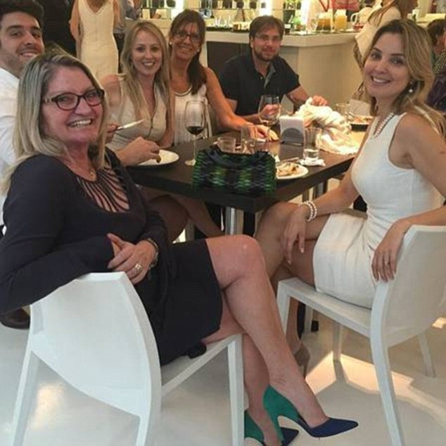 The good life: Marcela's mum Norma joined Marcela and her son on a shopping holiday to New York and another to Miami, just to celebrate Brazil's 'children's day'. Above, the family enjoy a fancy meal out