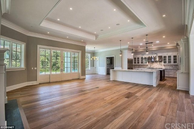 Room for the whole family: The plan is open space with the kitchen looking out to the den