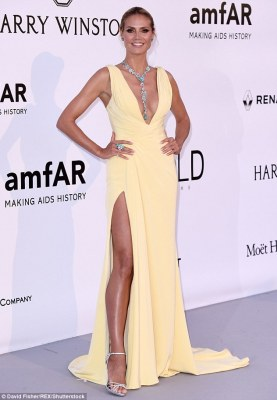 Mellow yellow: Supermodel Heidi Klum arrived at the amfAR Cinema Against AIDS Gala in Antibes, France on Thursday night