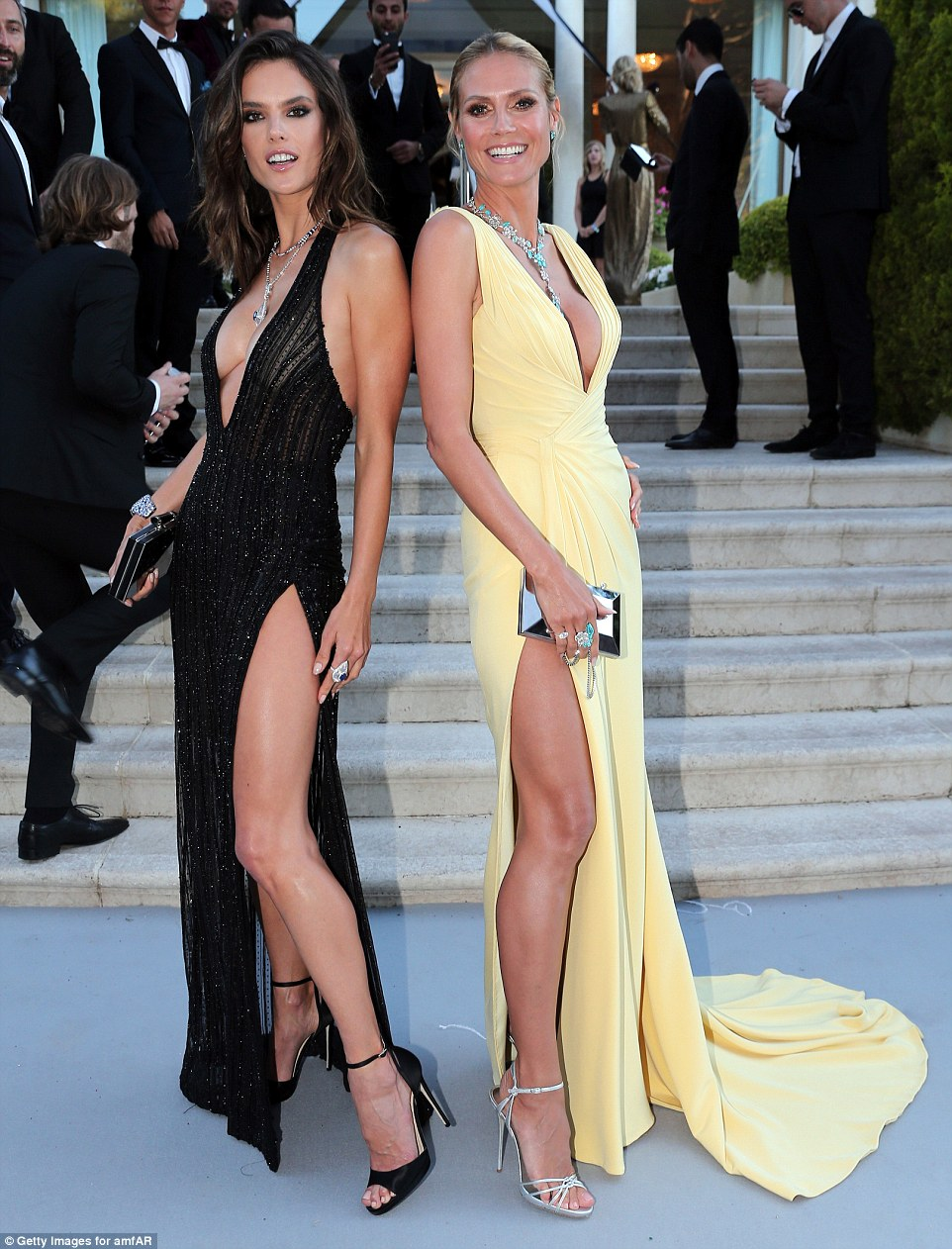 Legs eleven: The pair had certainly gone for similar styles with plunging necklines and thigh-high splits