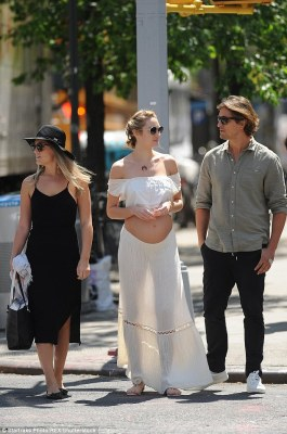 Day out: The couple were joined by a friend for their sunny stroll