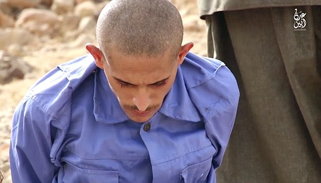 All of the Yemeni prisoners appears to have been forced to wear matching blue uniforms