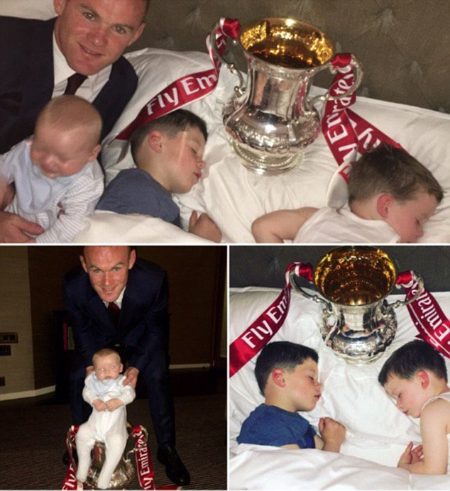 Wayne Rooney poses his children with the FA Cup after saying victory had fulfilled his childhood dream