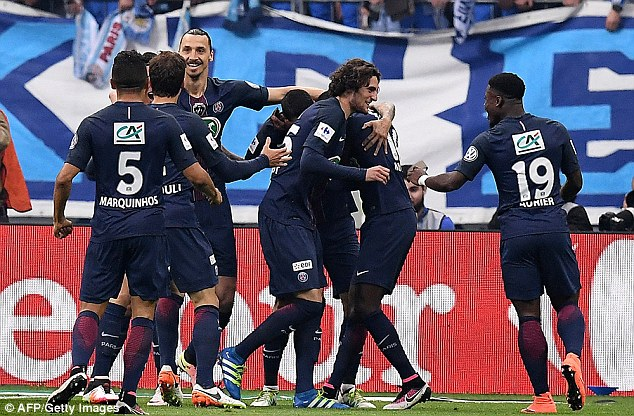 Matuidi is mobbed by his PSG team-mates as the Ligue 1 winners take an early lead