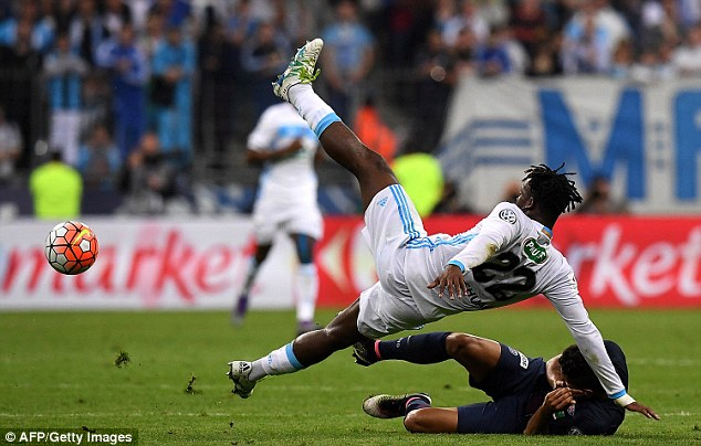 Michy Batshuayi (top), who has been linked with a Premier League move, goes down under a challenge