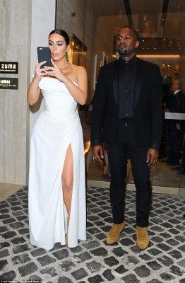 That's amore: The reality TV queen led the glamour as she was among the first stars to arrive for the uber-chic opening of Sofia Coppola's take on La Traviata alongside husband Kanye West