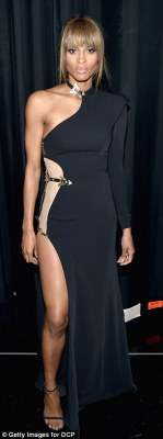 Glam looks: The mother-of-one was also seen in a sequined sweater style dress and an asymmetric gown with gold details