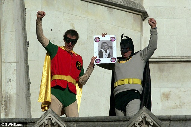 High-profile stunt: Her father Jonathan 'Jolly' Stanesby (left) began campaigning in October 2003 when he scaled the Royal Courts of Justice with a fellow Fathers4Justice activist dressed as Batman and Robin