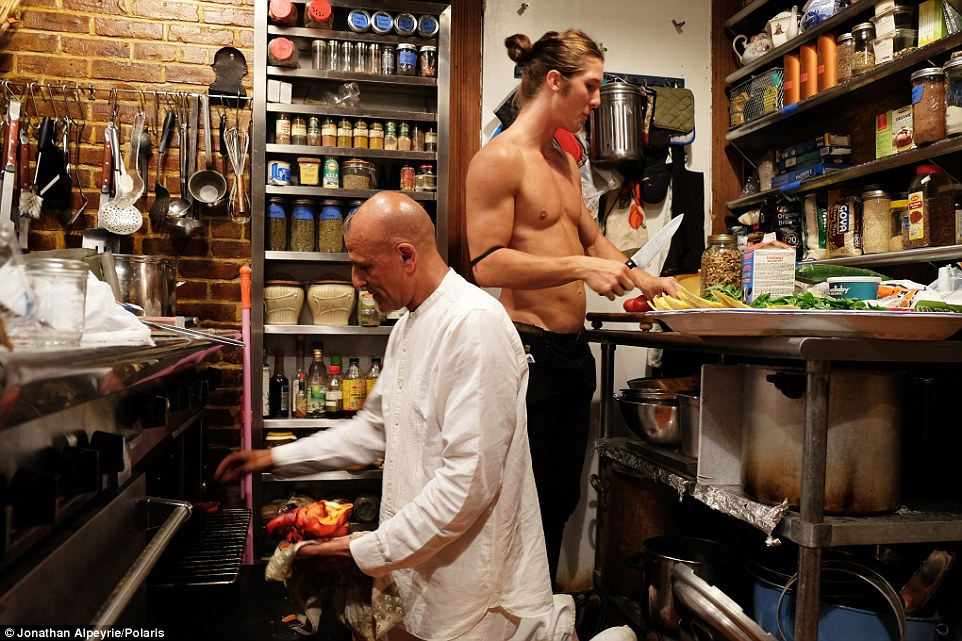 A good team: Michel is cooking inside his home while his lover Rasmus chops up fruit for guests to enjoy