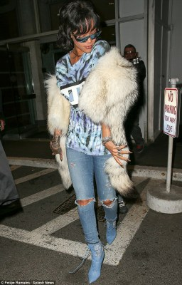 All about the accessories: She added a a chinchilla fur wrap and lace up boots