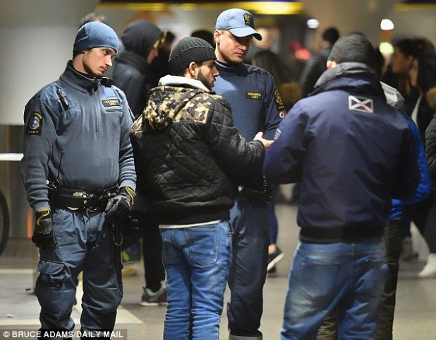 Swedish police check ID and question migrants in Stockholm Central Station.Sweden said it expected around 60,000 asylum seekers in 2016