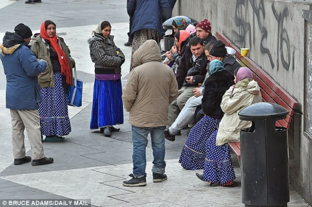 Swedish police have blamed the rise of migrant sex attacks on 'Nordic alcohol culture' and the 'non-traditional gender roles' of European women. Pictured:Romany migrants gather in Sergels Torg square in Stockholm