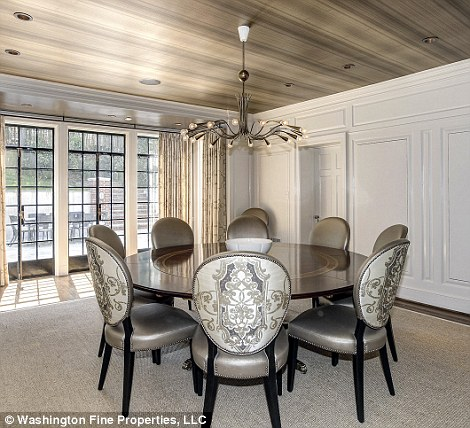 Table space: A dining room with wood flooring can serve as an entertainment space, or a place for 'kitchen table' discussions about the family budget