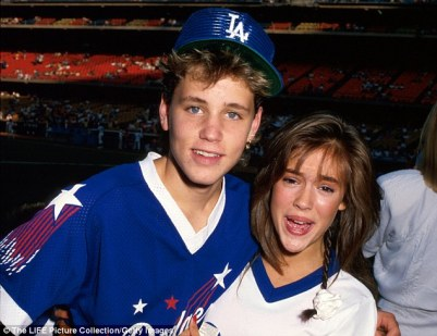 Happier days: Haim and his then girlfriend Alyssa Milano at a baseball game in 1986 (above)