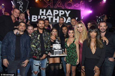 Work of art! The group shared a snap with Scott's impressive birthday cake, with Kourtney and her ex taking centre stage