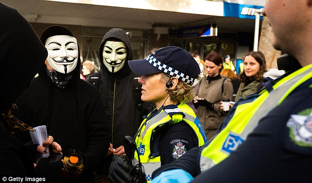 Acting Premier James Merlino said: 'Protesters who wear face masks, carry weapons and engage in violent behaviour are cowards, and this behaviour is unacceptable.'