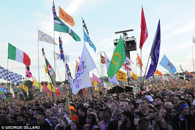 Music festivals, sports venues and nightclubs have been placed on 'high alert' for ISIS suicide attacks, according to a top anti-terrorism officer (pictured Glastonbury festival last year)