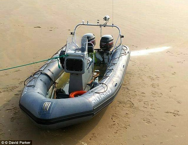 The inflatable power boat used by the migrants was spotted on the beach in Dymchurch, Kent, today