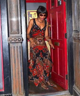 Supermodel style: The 46-year-old British fashion icon showed a hint of her cleavage in a vividly printed maxi dress