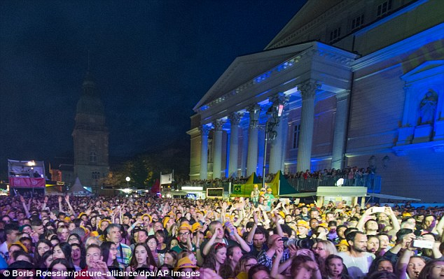 All the complainants said they were 'surrounded' before being 'touched and fondled' improperly at the annual free Schlossgrabenfestes music festival (file picture of the event)