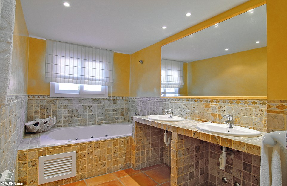 All tiled up: The spotlights add a modern twist to the tiled bathrooms