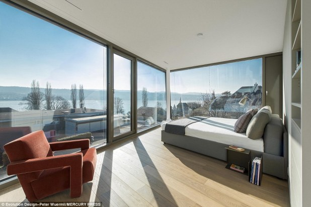 Morning greetings: The first-floor master bedroom offers views across Lake Zurich to the mountains beyond