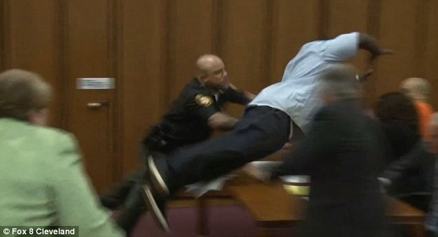 Terry then leaped over a table to attack the defendant in court just minutes after the judge pronounced a death sentence