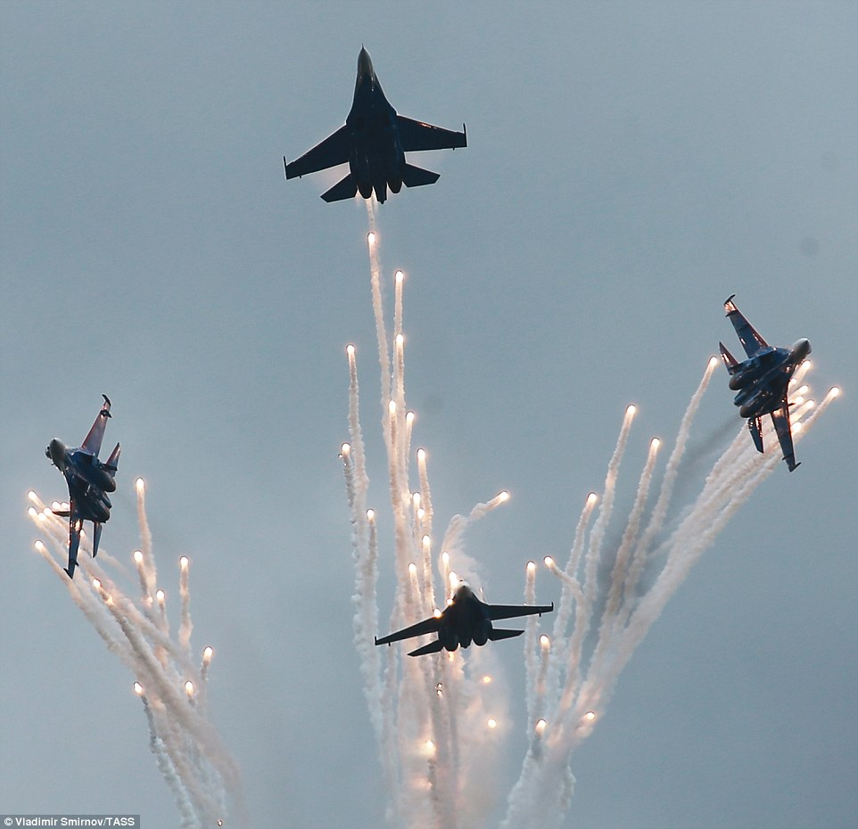 Sukhoi Su 27 fighter jets put on a display of precision as they dived out in all directions during the airshow