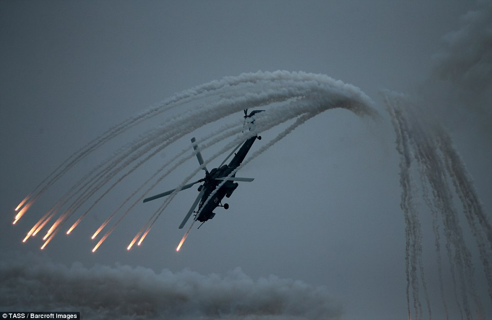 Vladimir Putin's air force put on a breathtaking show of skill, with a Kamov Ka-52 Alligator helicopter dipping down as a flurry of smoke enveloped it