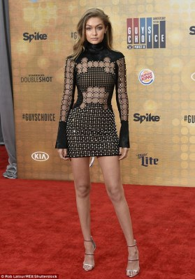 Crowd pleaser! Gigi Hadidstole the show at Spike TV's Guys Choice Awards in Los Angeles with her not-so-subtle sheer and sexy black dress that exposed her flat belly