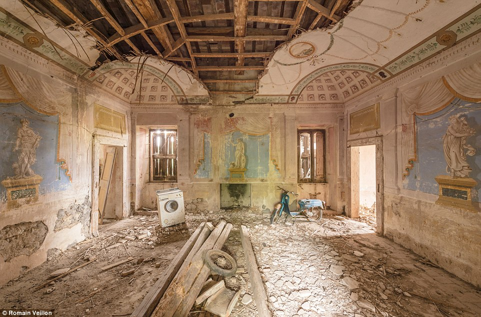 Impressive paintings adorn the crumbling walls of this property in Italy. Veillon prefers not to disclose the exact location of his photos
