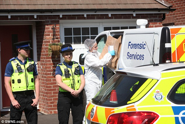 It has emerged a 61-year-old man from Leicester arrested on suspicion of murder on Sunday, is believed to be the couple's son-in-law, Steve Paxman. He is still in police custody (police are pictured searching his home)