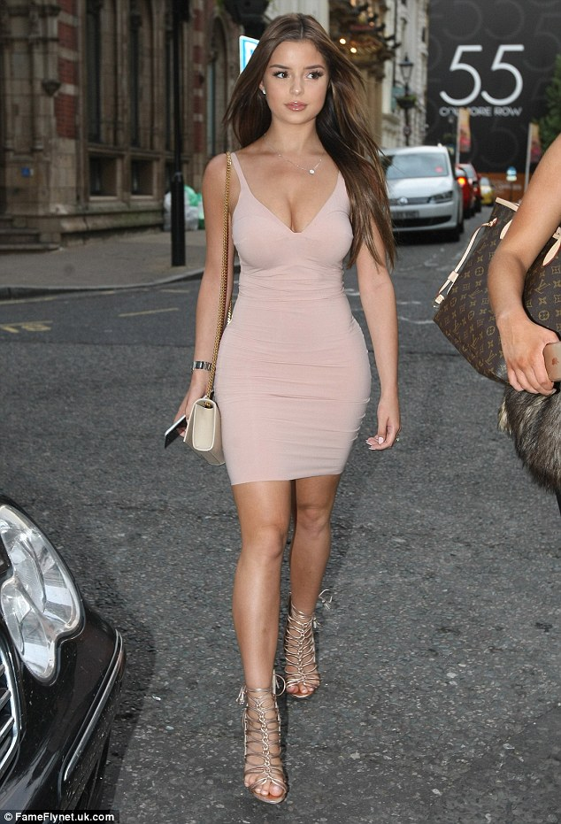 Sizzling: Busty Brummie beauty Demi Rose, 21, showed why she appears to have caught the rapper's eye when she stepped out with a pal for dinner at Fumo's in Birmingham on Tuesday