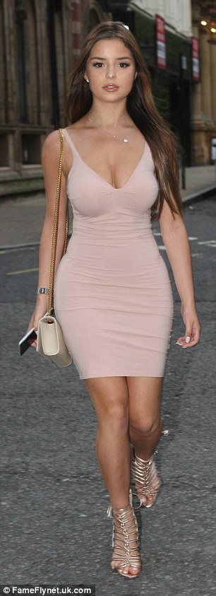 Looking good: The model looked sensational in a pale pink bodycon dress which highlighted her ample cleavage and her toned limbs