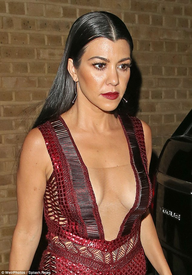 Take it easy: Kourtney Kardashian looked incredible but was at serious risk of a wardrobe malfunction in her embellished Julien Macdonald dress as the left the Glamour Awards in London on Tuesday