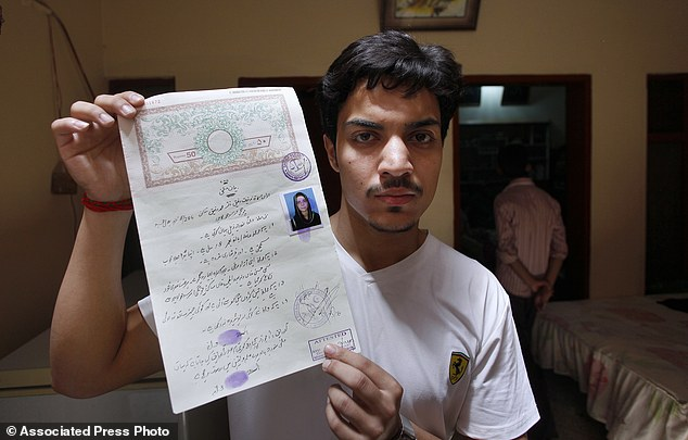 Defiance: Hassan Khan, shows his marriage certificate, proving that he married Zeenat in a civil ceremony, something which greatly angered her family