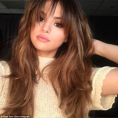 New and alluring look: Selena Gomez refreshed her hairstyle with wispy new bangs as seen in a snap posted to Nine Zero One Salon's Instagram page on Wednesday