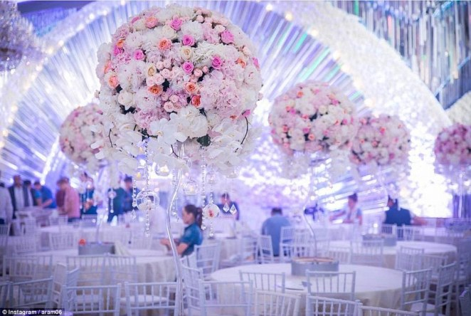 Their celebration was held at the famous Moscow restaurant Safisa, where tables were decorated with elaborate posies of pink and white flowers