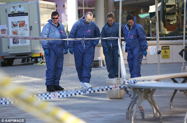 Forensic police look over the scene at Westfield Hornsby to gather evidence in the shooting