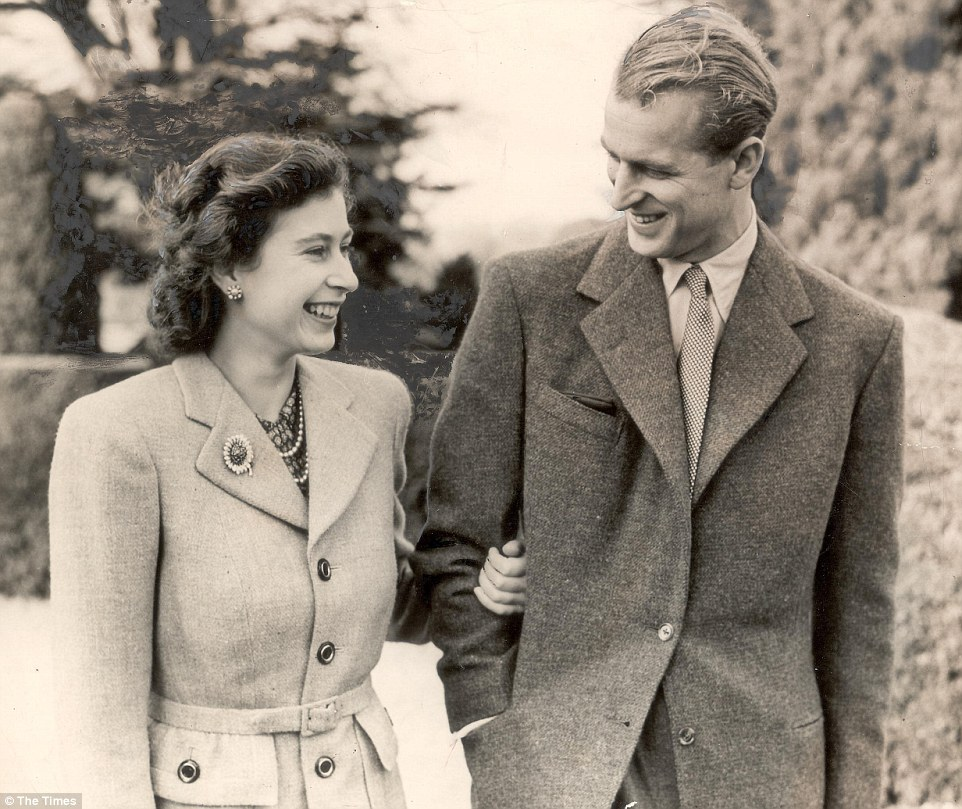 Affection: Princess Elizabeth takes her husband's arm as they step out for a stroll while on honeymoon in Hampshire, 1947