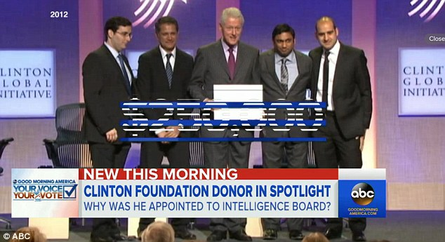 The Clinton Foundation associate also traveled to Africa once with Bill Clinton and has given between $1 and 5 million to the charity, its website says. He's seen here at a Clinton Foundation event with Bill Clinton