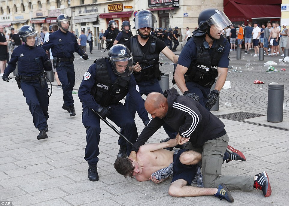 The same supporter is then apprehended by police as they take him in for his part in inciting the violence on Marseille's streets