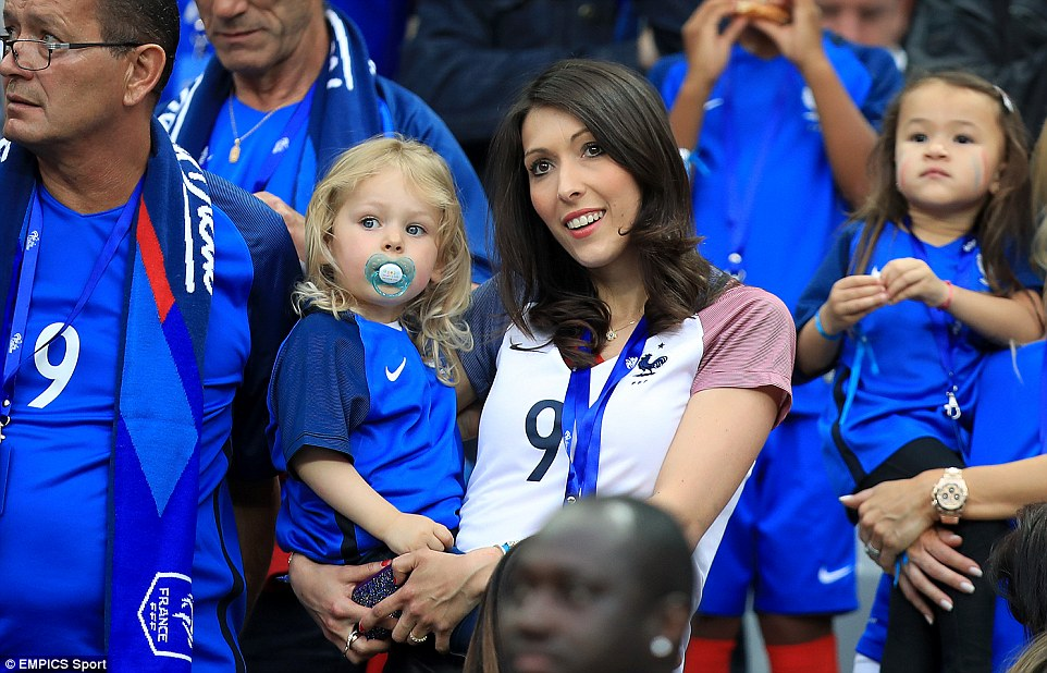 Jennifer Giroud watched her husband, Arsenal striker Olivier Giroud, open the scoring against Romania in the second half
